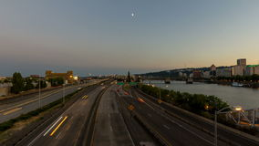 Time Lapse Movie of Long Exposure Traffic Light Trails and Moonrise in Downtown City or Portland Oregon at Sunset 1080p stock video