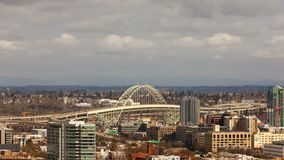 Time lapse movie of moving clouds and auto traffic in downtown city of Portland OR with Fremont Bridge 4k uhd stock footage