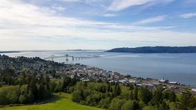Time Lapse Movie of Moving Clouds and Blue Sky over Coastal town of Astoria Oregon with Astoria-Megler Bridge 1920x1080 stock video footage