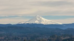 Time lapse movie of moving clouds over white snow covered Mount Hood from Jonsrud viewpoint in Portland OR stock footage