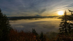 Time Lapse Movie of Moving Fog and Low Clouds with Snow Covered Mt. Hood One Early Morning at Sunrise 1080p stock footage