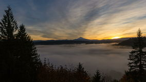 Time Lapse Movie of Sunrise with Blanket of Rolling Fog and Snow Covered Mt. Hood in Sandy Oregon from Jonsrud Viewpoint in Oregon stock video