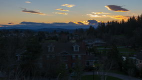 Time Lapse Movie of Sunrise over Suburb Homes in City of Happy Valley Oregon with Snow Covered Mount Hood One Early Winter Morning stock footage