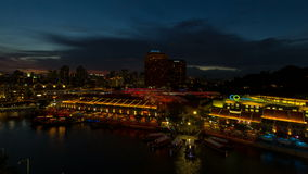 Time lapse movie of sunset into Blue Hour over Clark Quay in Singapore. stock video footage