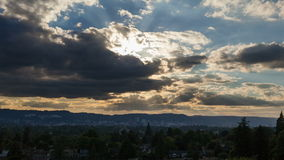Time Lapse Movie of Sunset with Dark Moving Clouds and Blue Sky over City of Portland Oregon from Mount Tabor 1920x1080 Stock Image