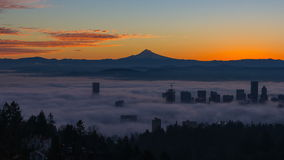 Time Lapse Movie of Thick Dense Rolling Fog Over Downtown City of Portland Oregon with Snow Covered Mount Hood One Early Morning stock footage