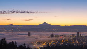 Time Lapse Movie of Thick Dense Rolling Fog Over Downtown Cityscape of Portland Oregon with Snow Covered Mt. Hood 1080p stock footage