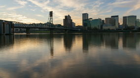 Time Lapse of Moving Clouds along Willamette River with Downtown Cityscape Hawthorne Bridge and Water Reflection at Sunset 1080p stock footage