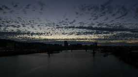 Time Lapse of Moving Clouds and Blue Sky Over Downtown Portland Oregon with Tilikum Crossing. And Marquam Freeway along Willamette River at Sunset into Blue stock video