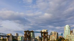 Time lapse of moving clouds and blue sky over Granville Island False Creek ferry dock in Vancouver BC Canada stock video
