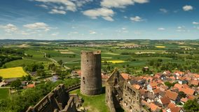 Time lapse - Moving clouds over castle Muenzenberg stock video footage