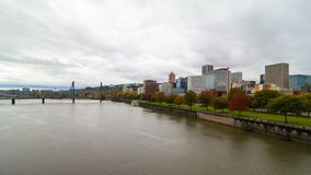 Time lapse of moving clouds over downtown city skyline of Portland Oregon along Willamette River 4k stock footage