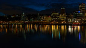 Time Lapse of Moving Clouds Over Downtown City Skyline of Portland Oregon with Hawthorne Bridge and Water Reflection at Night stock video