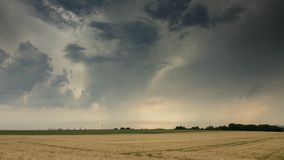 Time Lapse - Moving clouds over a field in summer with Frankfurt am Main in the distance stock footage