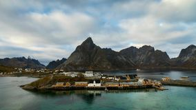 Time lapse - moving clouds over the fishing village of Sakrisoy stock video
