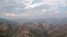 Time lapse - Moving clouds over the The Judaean Desert in Israel. Time lapse - Moving storm clouds over the The Judaean Desert, Midbar Yehuda stock video footage