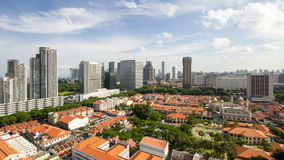Time lapse of moving clouds  over Kampong Glam with Singapore cityscape stock footage