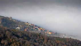 TIME-LAPSE: Moving Fog over the Village of Nerezi Stock Photography