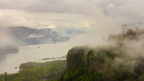 Time lapse of moving low clouds and fog along Columbia River Gorge and over historic Vista House in Portland OR 4k stock footage