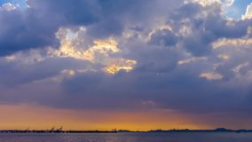 Time lapse of nice clouds movement with sunset over the sea-Tilt up. 4K Time lapse of nice clouds movement with sunset over the sea-Tilt up stock video