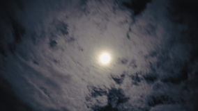 Time lapse night clouds with moon stock footage