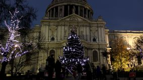 Time lapse. Night London. Bright Christmas tree in front of St. Paul`s Cathedral.
