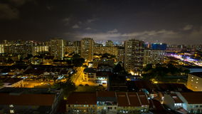 Time lapse of night scene and moving clouds at Joo Chiat with Singapore cityscape.