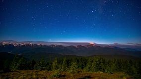 Time lapse of the night sky in the mountains stock video footage