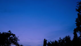 Time-lapse of Night Sky Turning from Evening to Dusk 4. A time-lapse shot of the night sky as it transitions from evening to twilight stock video
