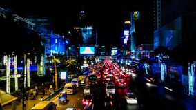 Time lapse of night traffic at Ratchaprasong Intersection stock video footage