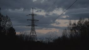 Time lapse of nightfall with transmission tower stock video footage
