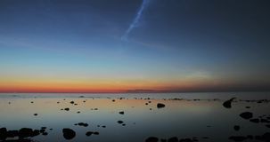 Time lapse of noctilucent clouds. Above the Baltic Sea stock footage