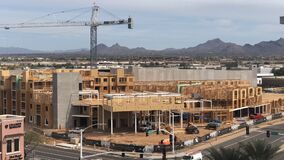 Time-lapse North Scottsdale area view of McDowell Mountain with crane. Overlooking construction and clouds swirling by stock video