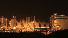 Time-lapse of Oil refinery industrial plant at night, Thailand stock footage