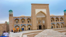 Time-lapse of old Madrassah. KHIVA, UZBEKISTAN – MAY 3, 2015: The time-lapse of Madrassah of Kutlug-Murad-inak is the famous landmark of medieval town located stock video