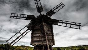 Time lapse old windmill on the background of dramatic clouds stock video footage