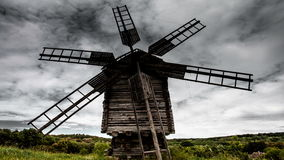 Time lapse old windmill on the background of dramatic clouds stock footage