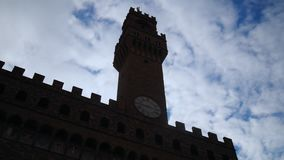 Time lapse of Palazzo Vecchio, Florence. Florence, October 2017: time lapse of Palazzo Vecchio on a cloudy day, on October 2017 in Florence, Tuscany, Italyn stock video