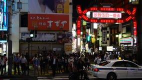 Time Lapse Pan of Busy Shinjuku Entertainment / Shopping District at Night - Tokyo Japan stock video footage