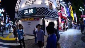 Time Lapse Pan of Busy Shinjuku Entertainment / Shopping District at Night - Tokyo Japan stock footage