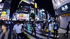 Time Lapse Pan of Busy Shinjuku Entertainment / Shopping District at Night - Tokyo Japan stock video