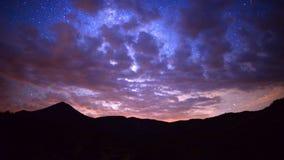 Time Lapse Pan of Mountain Range at Night - 4K stock footage