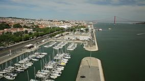 Bridge of 25 April time lapse. Time lapse panorama of Bridge of 25 April or Ponte 25 de Abril and Tagus or Tejo river from Discoveries Monument or Padrao dos stock footage