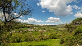 Time lapse panorama green grass, hills, mountain with moving clouds. 4K. Veneto stock video