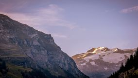 Time lapse of a panoramic view of Mount Rose at sunset in the Gressoney valley in summer. Mount Rose, Monte Rosa in Italian, is the second highest mountain in stock video footage