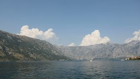 TIME LAPSE of part of the KOTOR BAY. With clouds over the hill stock video