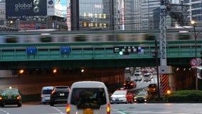 Time Lapse - Passenger Train with Busy Street Traffic in Shinjuku - Tokyo Japan. Famous City of Shinjuku - Tokyo Japan stock footage