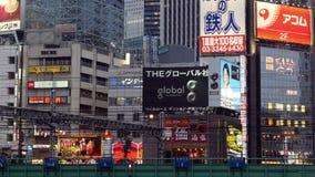 Time Lapse - Passenger Train with Busy Street Traffic in Shinjuku - Tokyo Japan. Famous City of Shinjuku - Tokyo Japan stock video footage