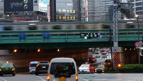 Time Lapse - Passenger Train with Traffic in Shinjuku - Tokyo Japan stock video footage