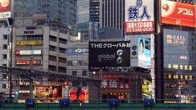 Time Lapse - Passenger Train with Traffic in Shinjuku - Tokyo Japan. Famous City of Shinjuku - Tokyo Japan stock video
